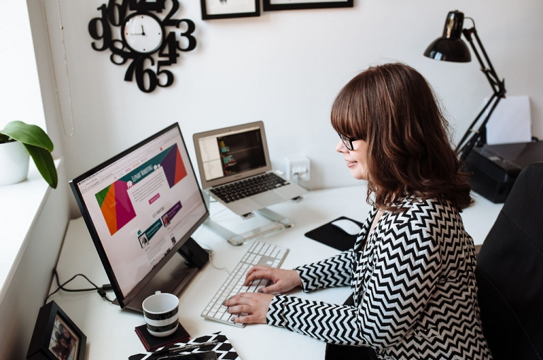 relaxed photo of a young woman working at a desk
